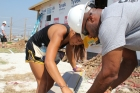 Katelyn Trevino and Pat Ivey of the University of Missouri cut siding for houses built under the Governor's Joplin Challenge following a devastating 2011 tornado in Joplin, Missouri.